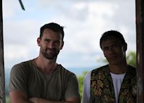 Mat with his guide trekking in search of tarsiers, Bohol, Philippines