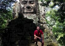 Ross a the northern gate of Angkor Thom, Cambodia