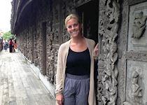 Blair exploring a teak wood monastery in Mandalay, Myanmar