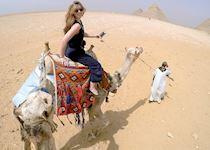 Riding a camel at the Giza Pyramids
