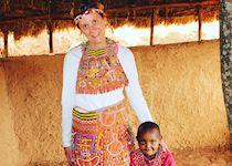 Katie wearing a tribal wedding dress in Tloma Village in Tanzania