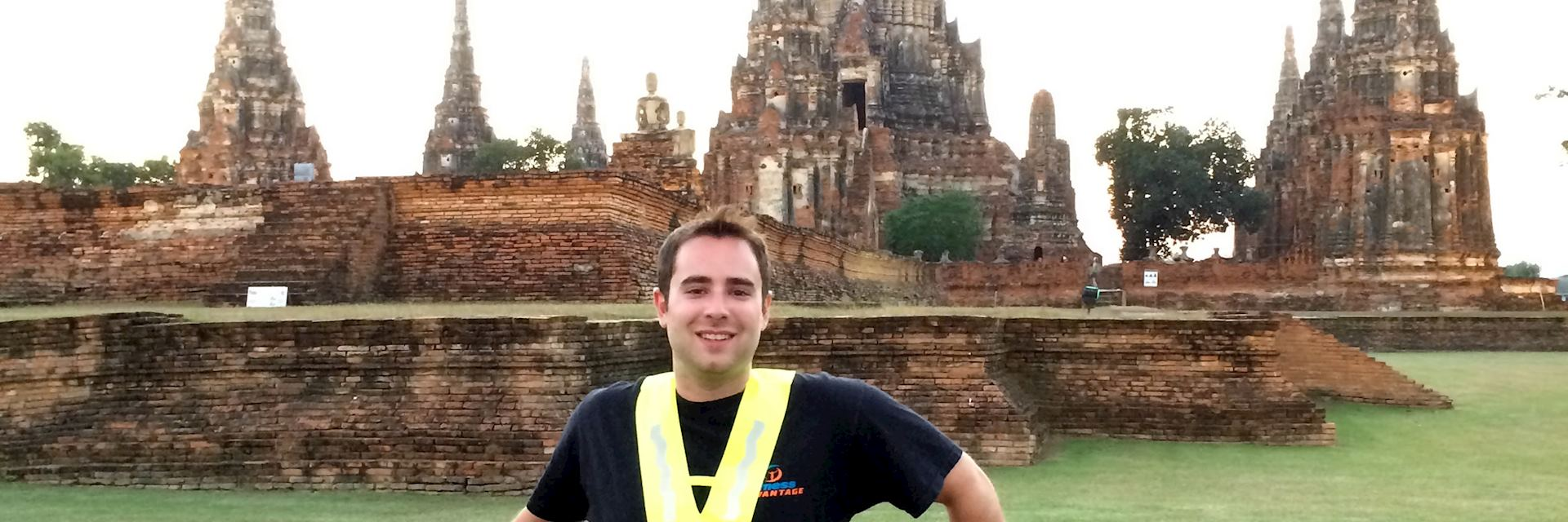 Matt on a bicycle excursion stops off at one of the ancient temples in Ayutthaya, Thailand