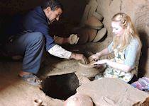Talia making pottery in a village